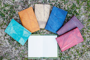 vegan A6 note books. Blue, Orange Natural, Teal, Brown Red, Green. Cruelty-free teak leaf cover. Re-fillable design