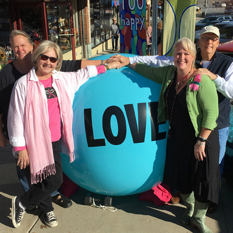 Casey and Sloane with their parents and a Big Love Ball