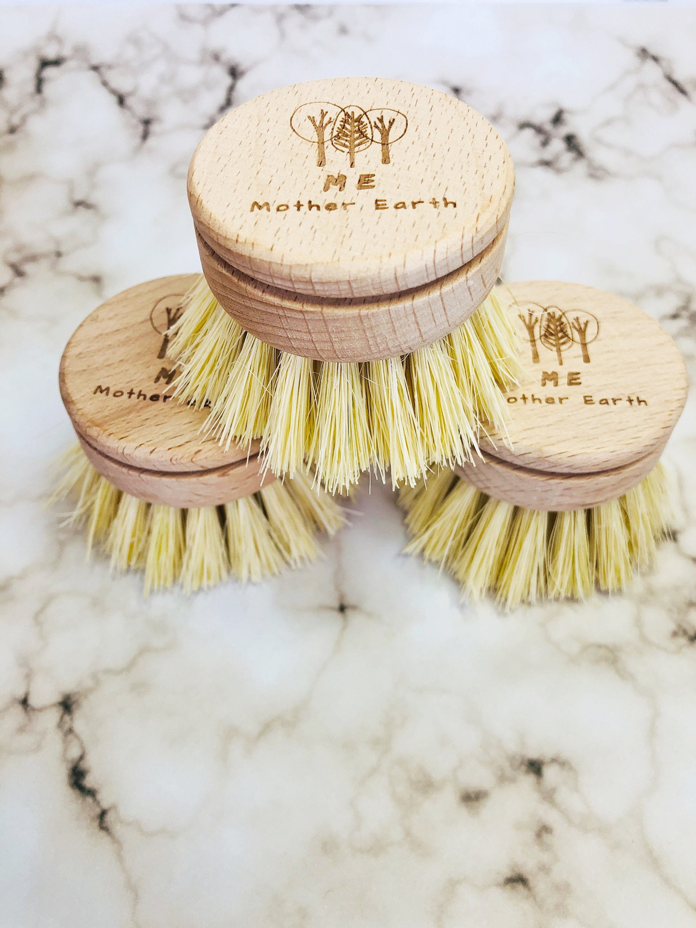 three cleaning brush replacement heads