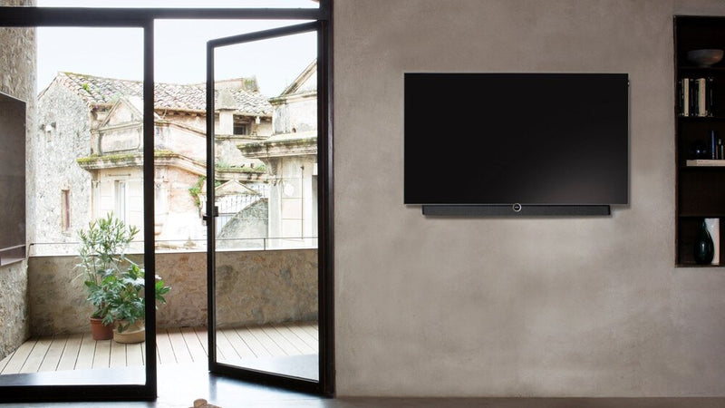 "Loewe bild 5 55"" OLED TV with Silver Oak Floor Stand wall mounted"