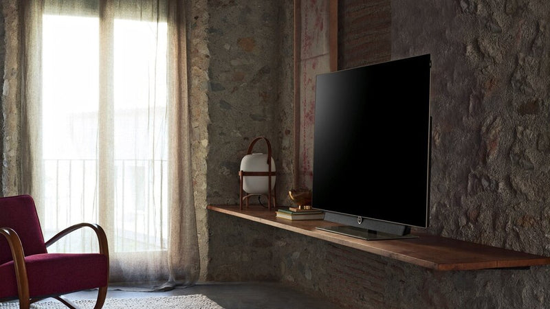"Loewe bild 5 65"" OLED TV with Table Stand on the floating shelve"