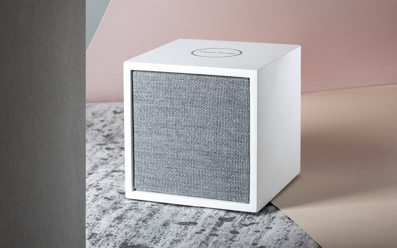 Tivoli Cube Wireless Speaker on brushed surface