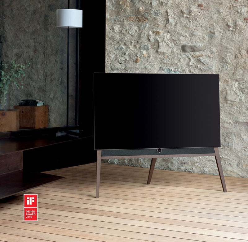 "Loewe bild 5 55"" OLED TV with Silver Oak Floor Stand in the corner"