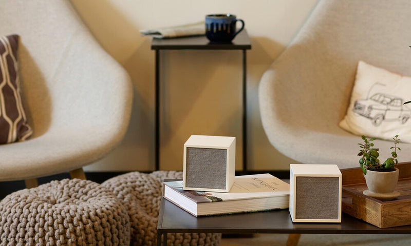 Tivoli Cube Wireless Speaker on top of a book