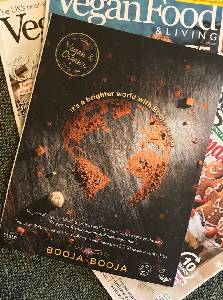 Booja-Booja advertisement from January 2021 edition of Vegan Food & Living magazine, featuring a cocoa powder Earth.