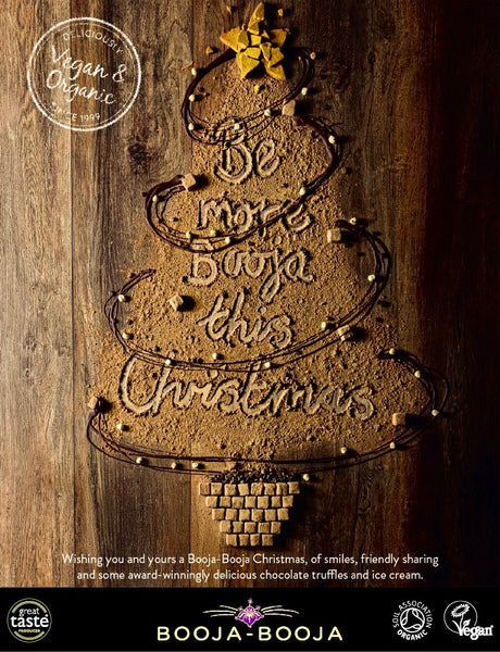 Booja-Booja advertisement on back page of Vegan Food & Living magazine, December 2020, featuring a Christmas tree made from cocoa powder with the headline: Be more Booja this Christmas