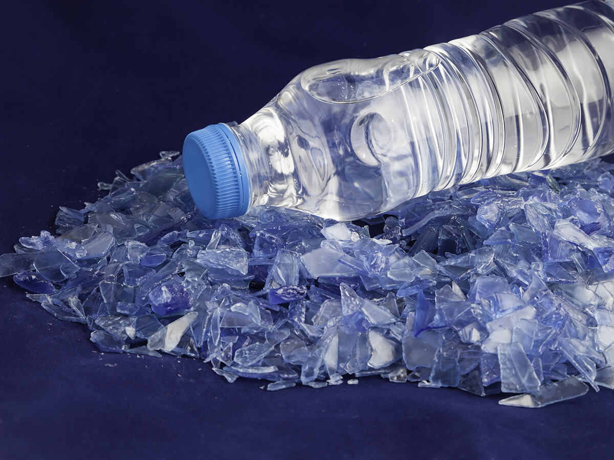 Single-use plastic water bottle, with blue background.