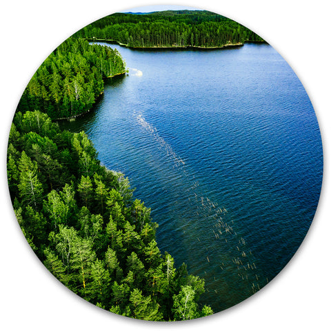 Beautiful forested area with clear blue water.