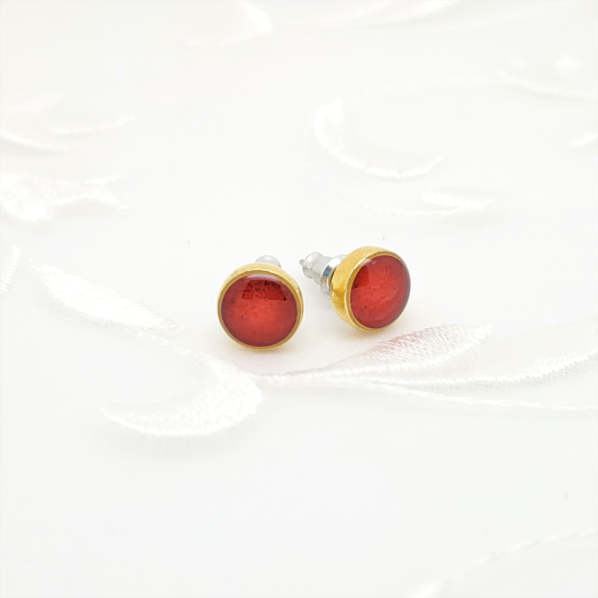 Antique Gold Round Stud Earrings with Transparent Red Resin