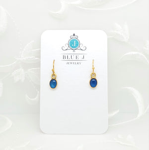 Antique Gold Tiny Oval Earrings with Transparent Sapphire Blue Resin