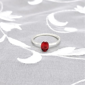 Sterling Silver Plated Oval Ring with Transparent Red Resin