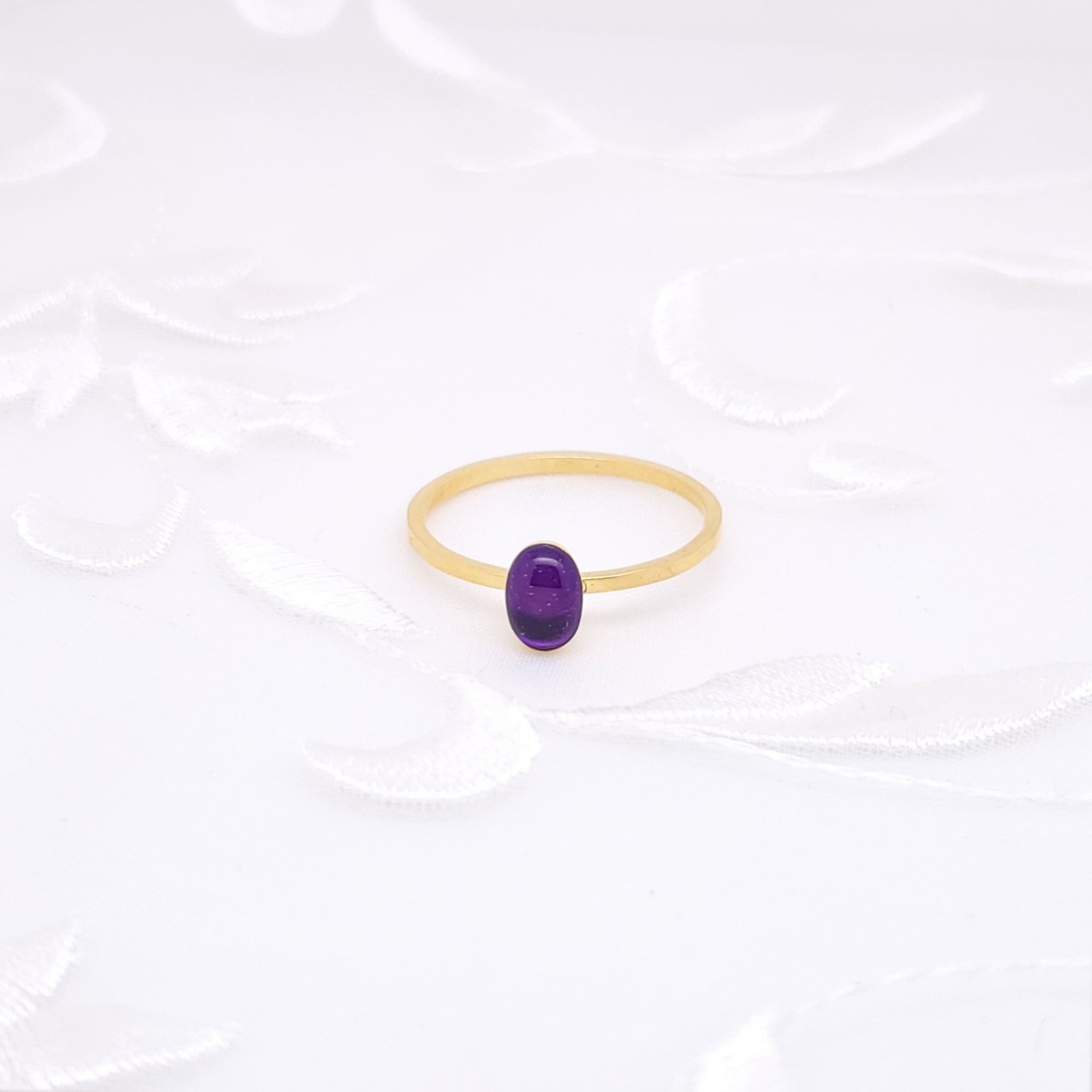 Antique Gold Oval Ring with Transparent Dark Purple Resin
