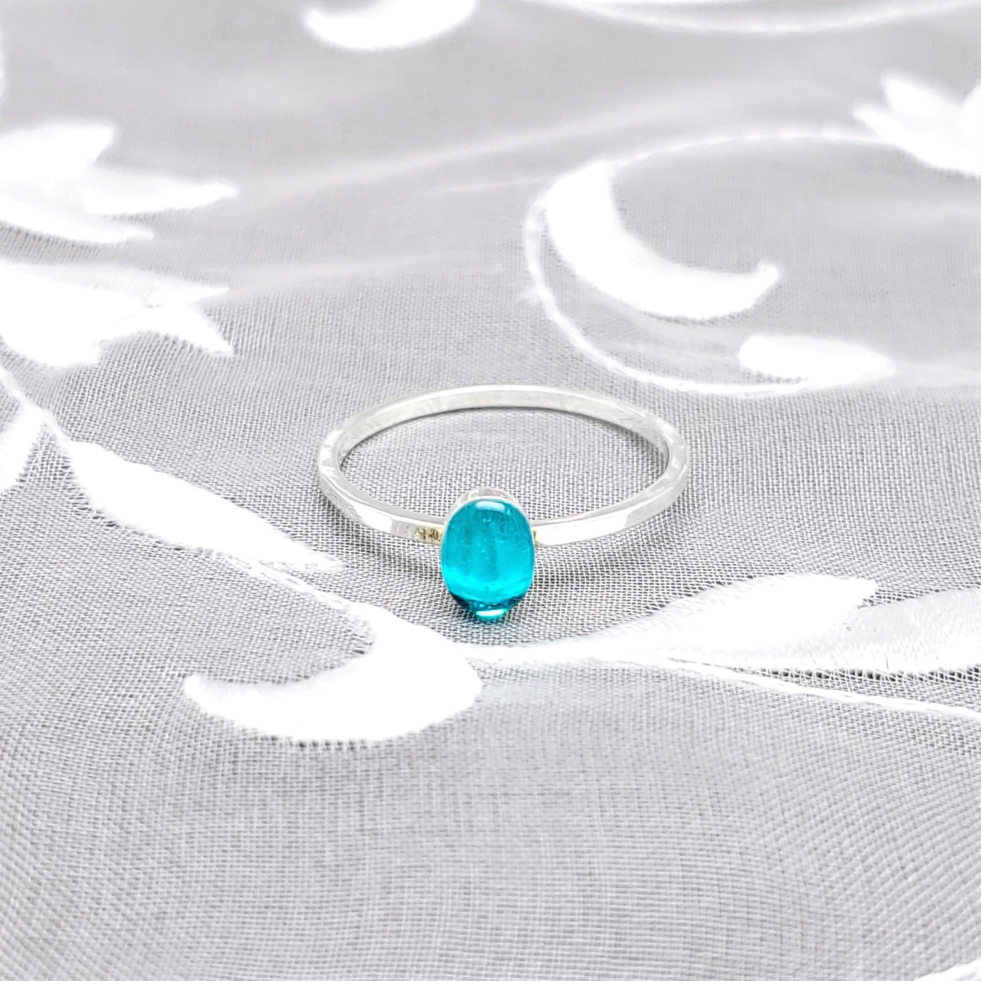 Sterling Silver Plated Oval Ring with Transparent Sky Blue Resin