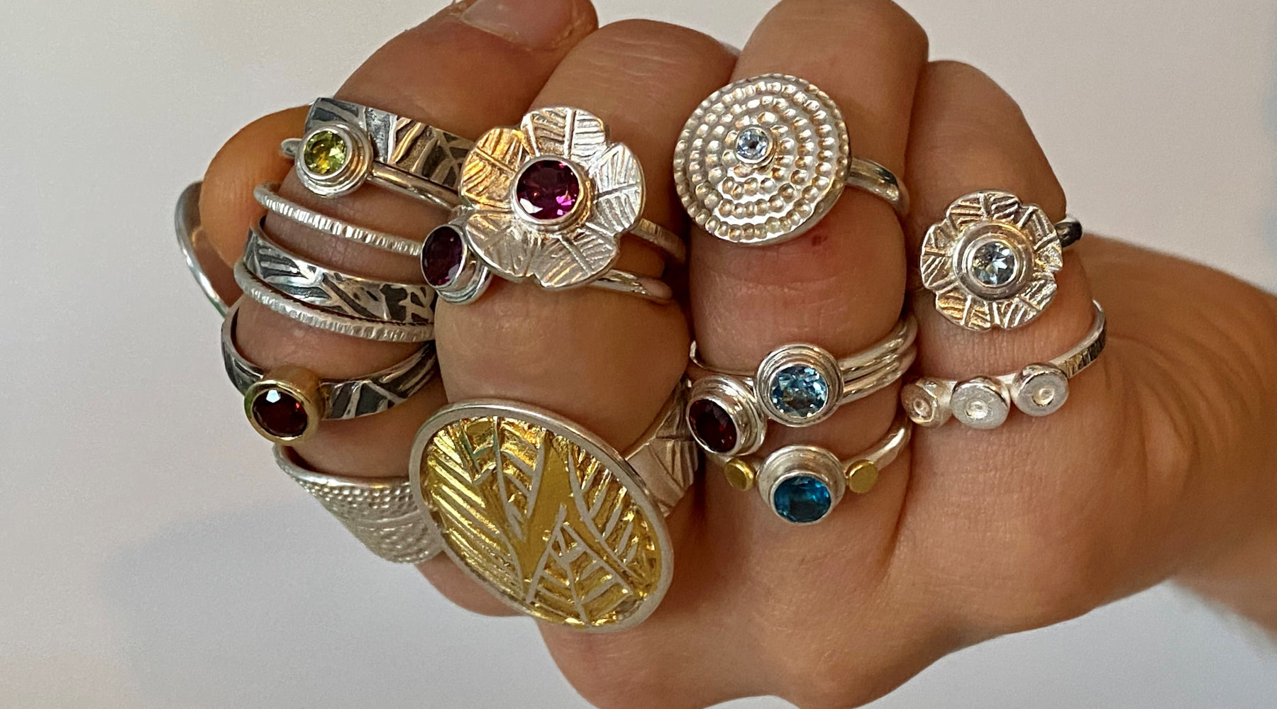 Handcrafted rings in silver and gold, with gemstones