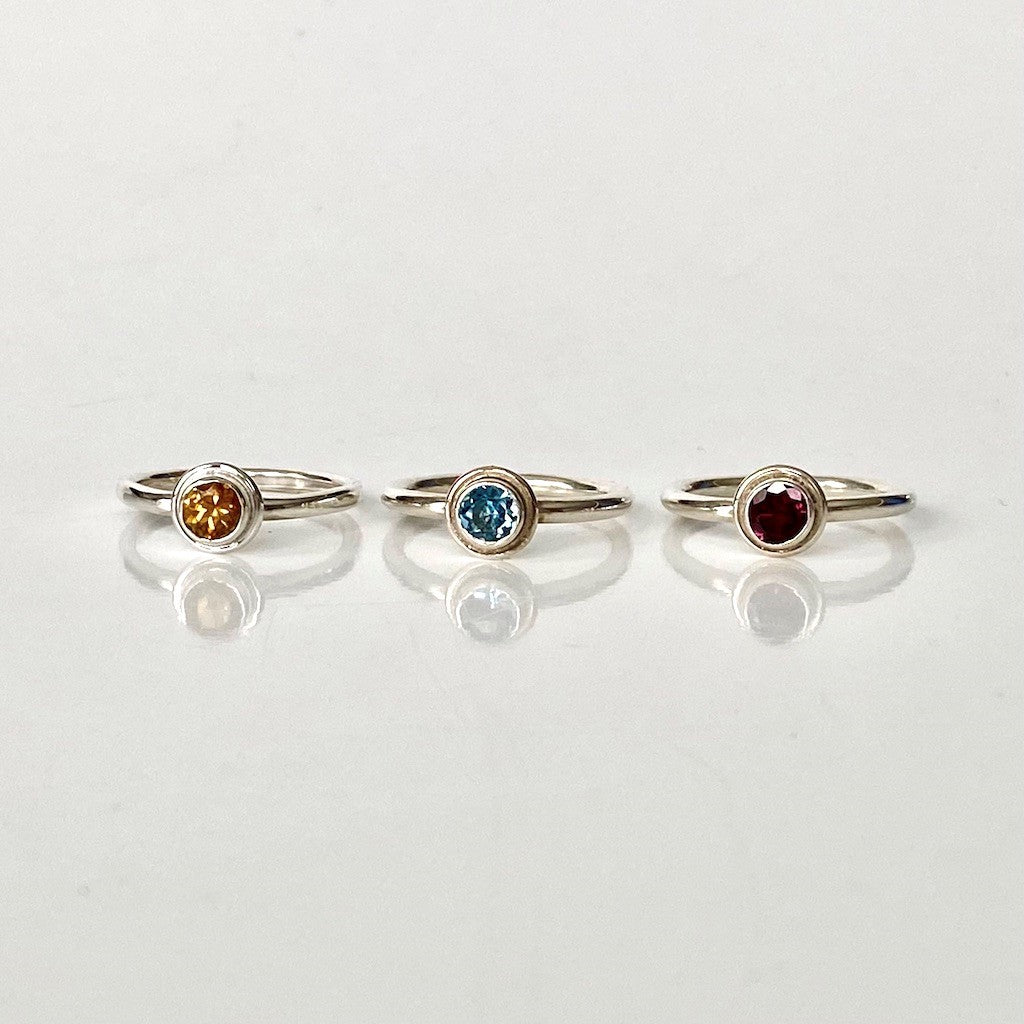 Essential Rings, silver with citrine, sky blue topaz, rhodolite garnet