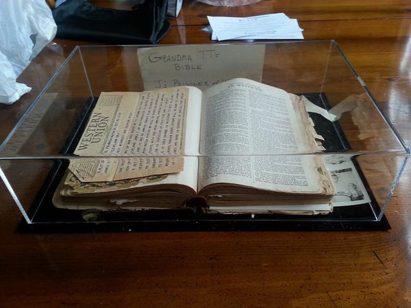 An old family Bible containing letters & telegrams from World War II sits in a book display case manufactured by Better Display Cases.