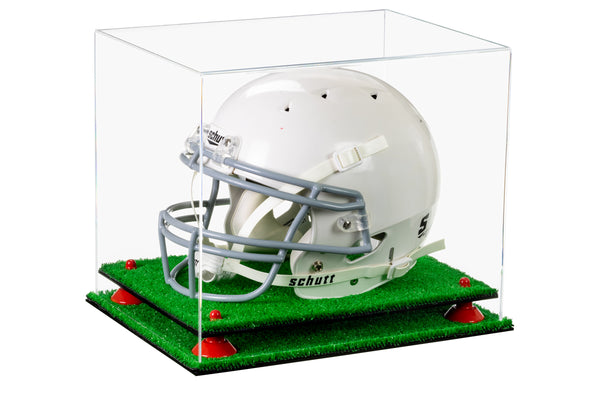 A football helmet sits on a turf base inside a clear acrylic display case manufactured by Better Display Cases