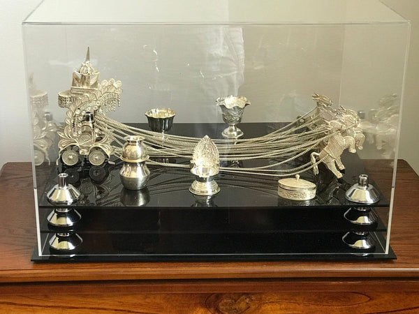 A beautiful silver Murti of the Hindu God Krishna is shown in a display case manufactured by Better Display Cases