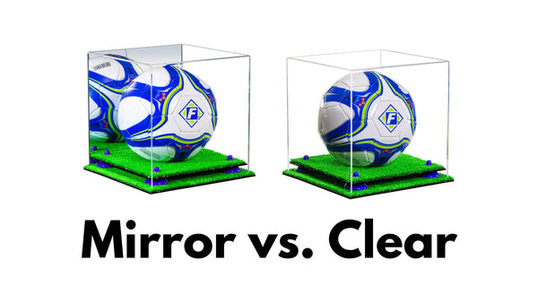 "Two display cases sit side by side for the purpose of comparison. One of the cases is a mirror display case, the other is a clear display case. The text reads ""Mirror Vs. Clear"""