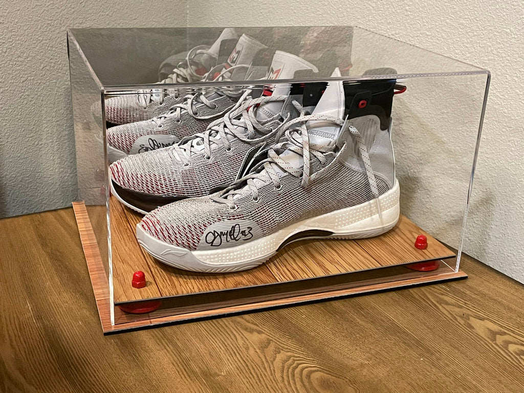 A pair of basketball shoes from the 2020 NBA Bubble worn by Portland Trail Blazers star CJ McCollum sits in a display case manufactured by Better Display Cases of Stafford, VA