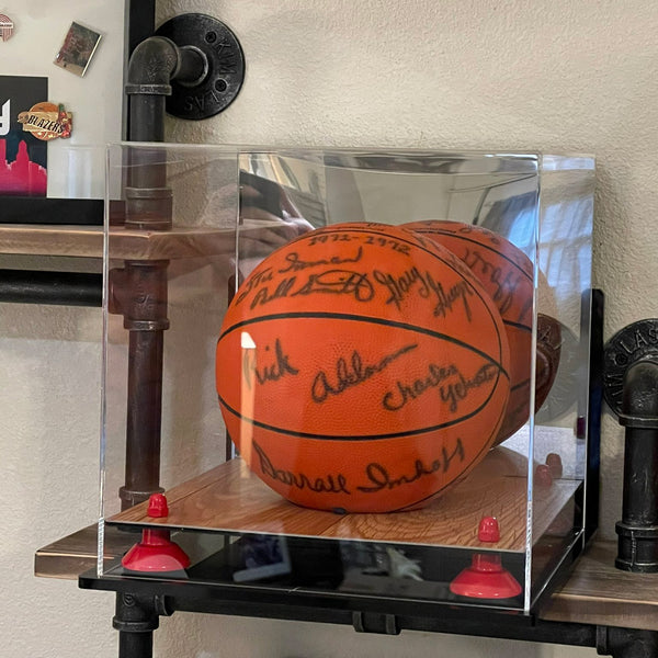 An autographed basketball from the 1971-1972 Portland Trail Blazers sits in a basketball display case manufactured by Better Display Cases. Player signatures visible include Rick Adelman, Darrall Imhoff, Charlie Yelverton, Geoff Petrie, Gary Gregor, Bill Smith along with the signature of interim head coach Stu Inman