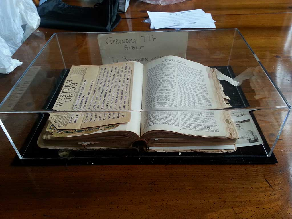 Book display case holds a family bible filled with history