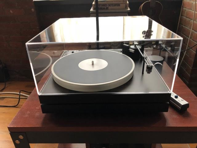 Display Case Used as a Cover for an Old Fashioned Record Player