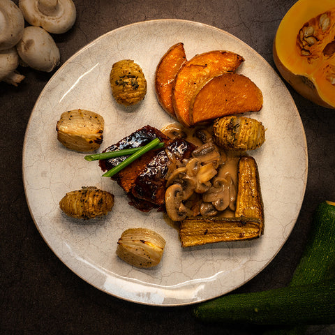 GRILLED SEITAN WITH GARLIC HASSELBACK POTATOES