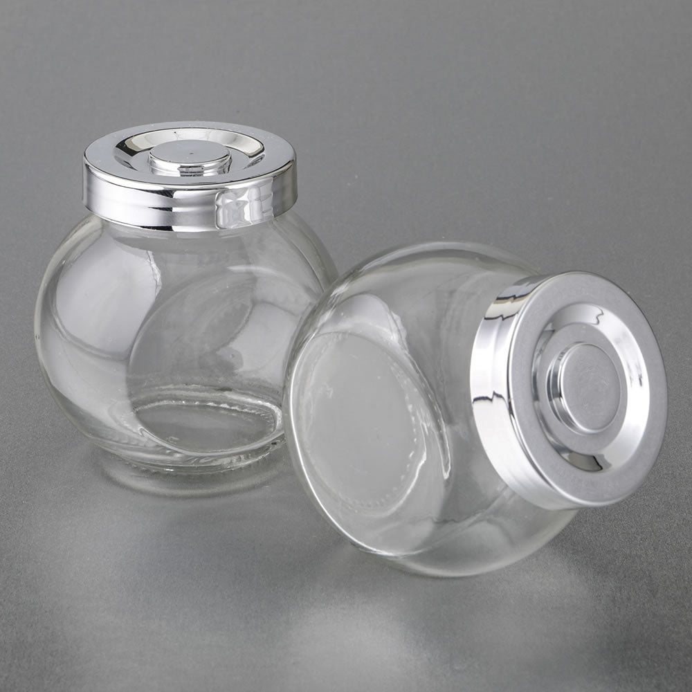 Candy Jar With A Silver Plated Plastic Vacuum Seal Cap