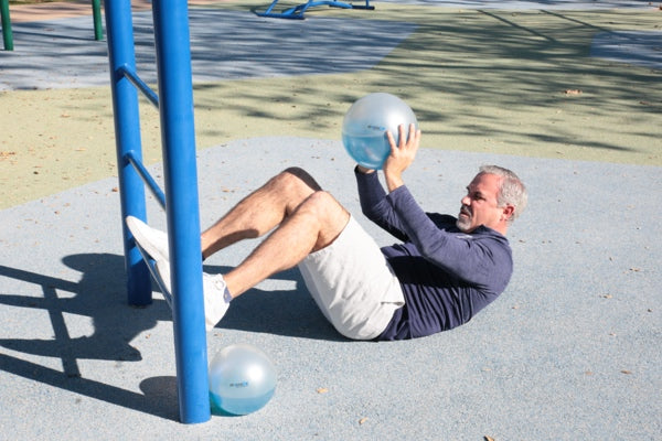man building strength and increasing stability using a SPHERA2.0 therapy medicine ball