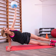 Load image into Gallery viewer, woman doing side plank exercises with weighted Sphera2.0 medicine ball in a home gym