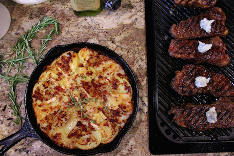 Seared Steaks with Roasted Garlic Rosemary Butter and a Potato, Brie, & Bacon Gratin