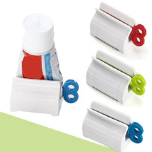 Load image into Gallery viewer, Convenient Toothpaste Dispenser Rolling Toothpaste Squeezer Stand Holder