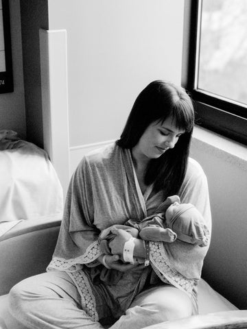 new mom holds her baby for a Fresh 48 Hospital Session