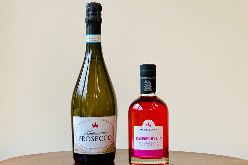 Escapism Cocktail Bundle, a bottle of prosecco and half bottle of Raspberry Gin Liqueur