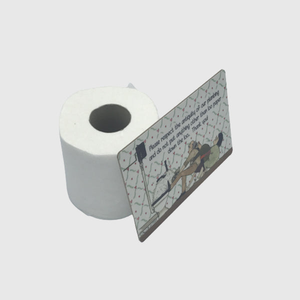 Loo roll with tottering by gently loo sign