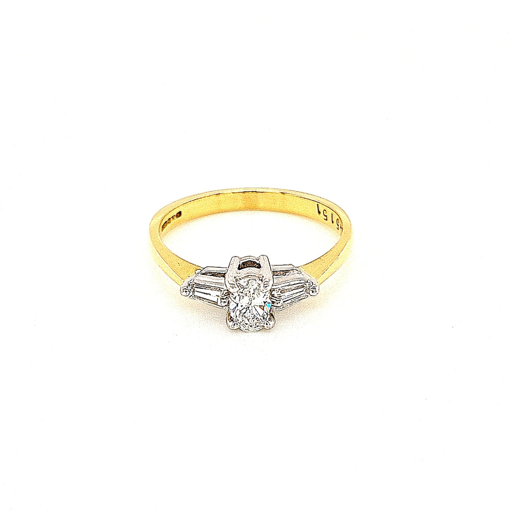 Oval Solitaire Diamond Engagement Ring with Baguette Sides