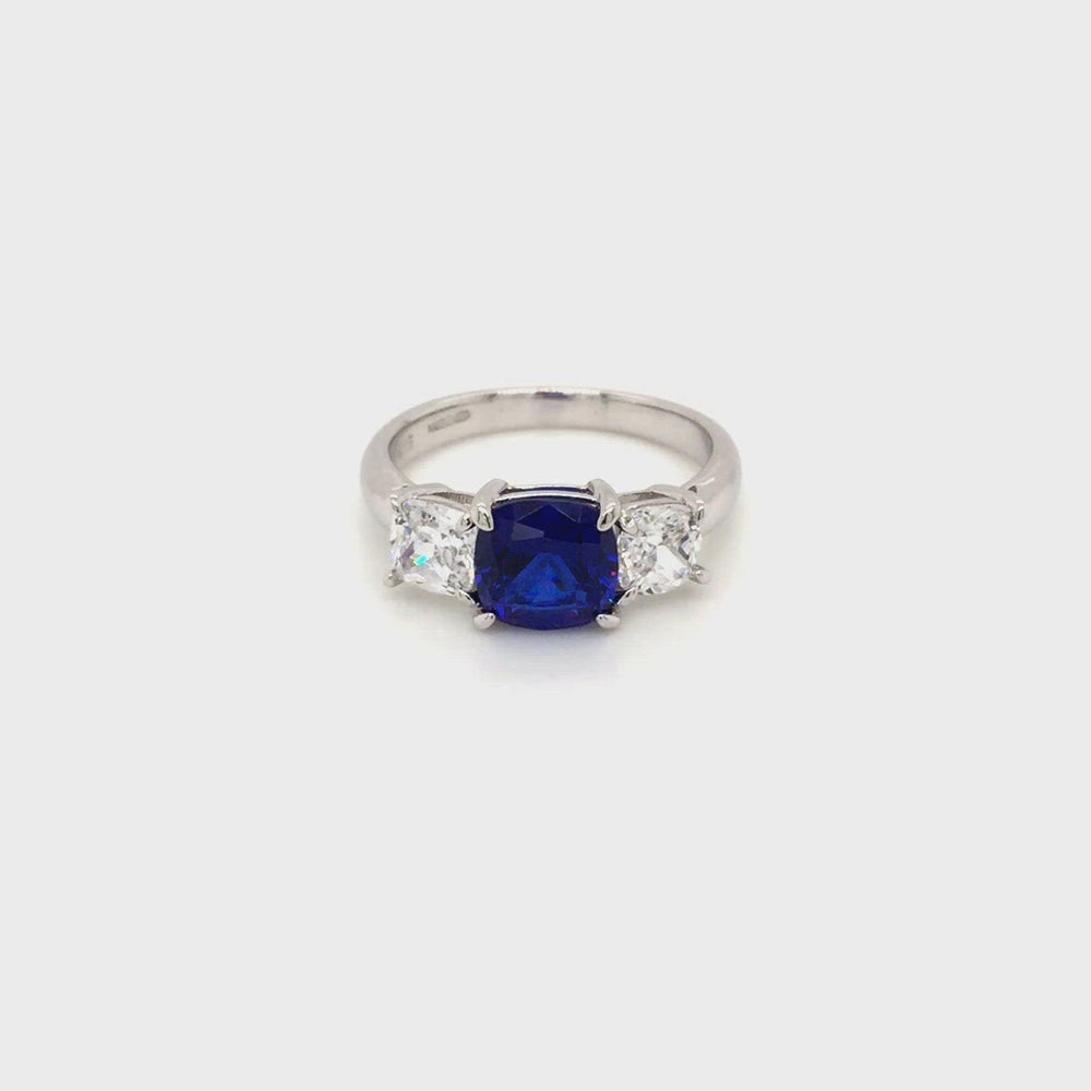 Load and play video in Gallery viewer, Sterling Silver Three Stone Sapphire Blue CZ Ring
