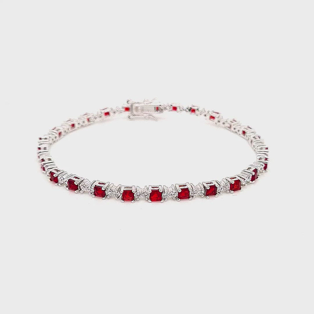 Load and play video in Gallery viewer, Sterling Silver Ruby CZ Tennis Bracelet
