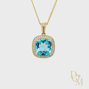 Load and play video in Gallery viewer, 9ct Yellow Gold Cushion-cut Blue Topaz & Diamond Cluster Pendant
