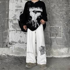 CROSS ANGEL PRINT LOOSE WIDE LEG PANTS