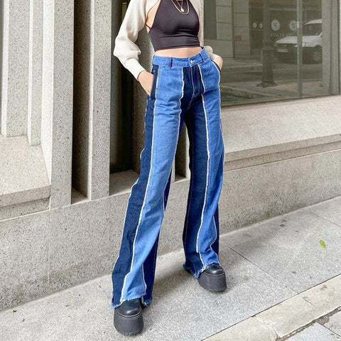 VERTICAL SPLICE FRINGED JEANS