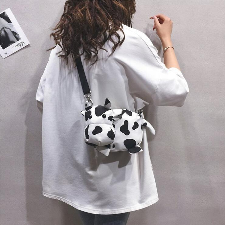 CONTRAST COW CANVAS CROSS BODY BAG