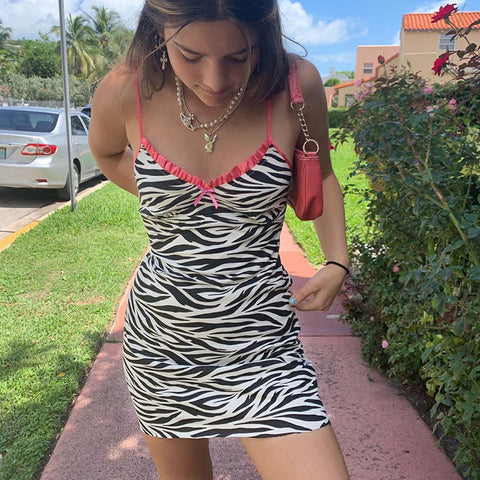 ZEBRA PRINT MINI SLING DRESS