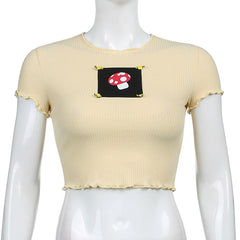 MUSHROOM EMBROIDERED CROP TOP