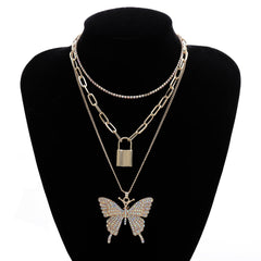 LOCK AND LARGE BUTTERFLY PENDANT LAYERED NECKLACE
