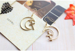HOLLOW MOON CROSS EARRINGS