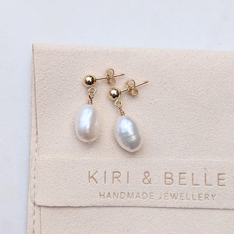 Ball stud single baroque pearl drop earrings