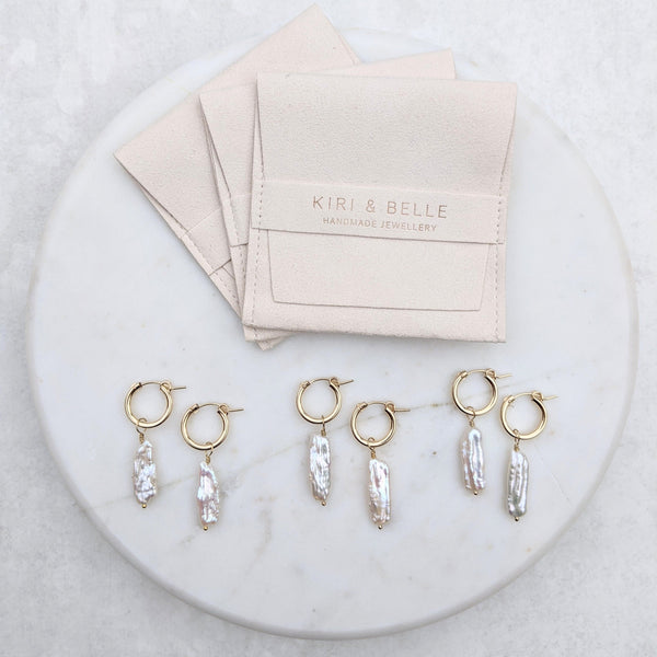 Biwa pearl gold hoop earrings with soft storage pouches