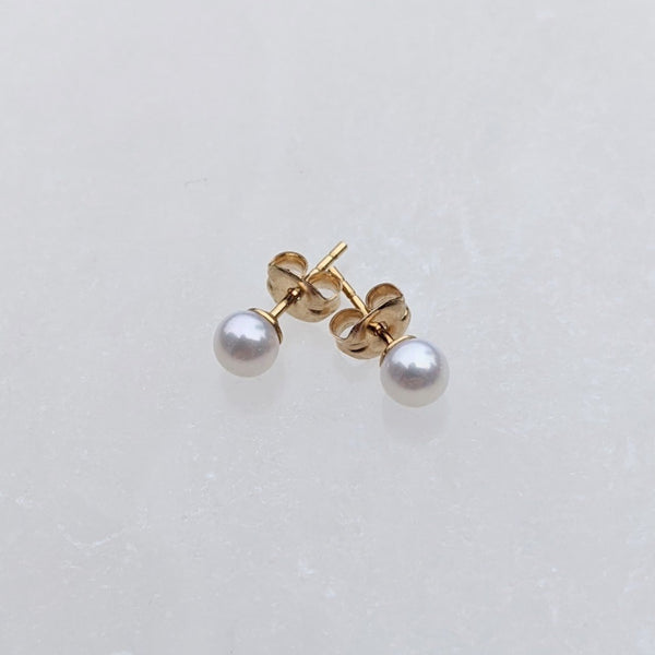 Small round pearl stud earrings